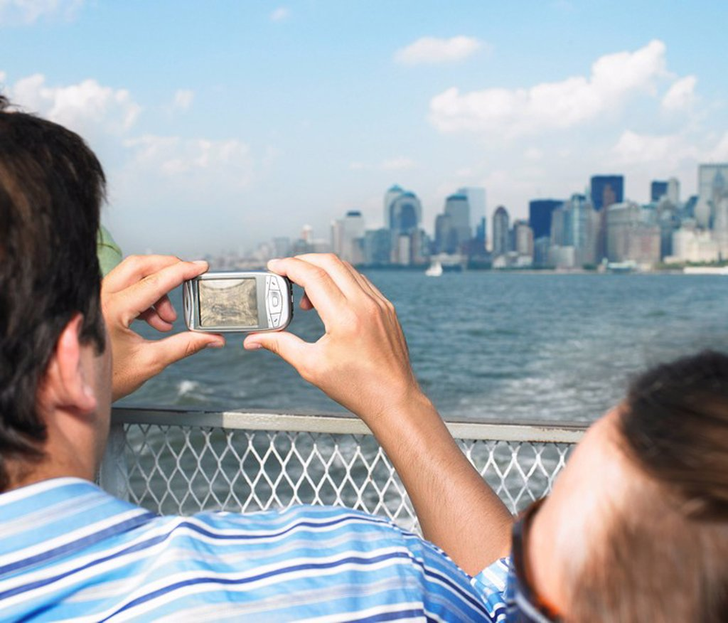 Stock Photo: 1773-28383 Man Taking picture of Cityscape
