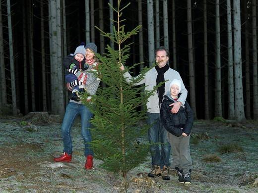 Family with christmas tree : Stock Photo