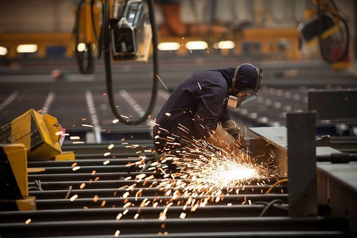 Work takes places at BAE Systems shipyard in Govan, on the banks of the River Clyde : Stock Photo