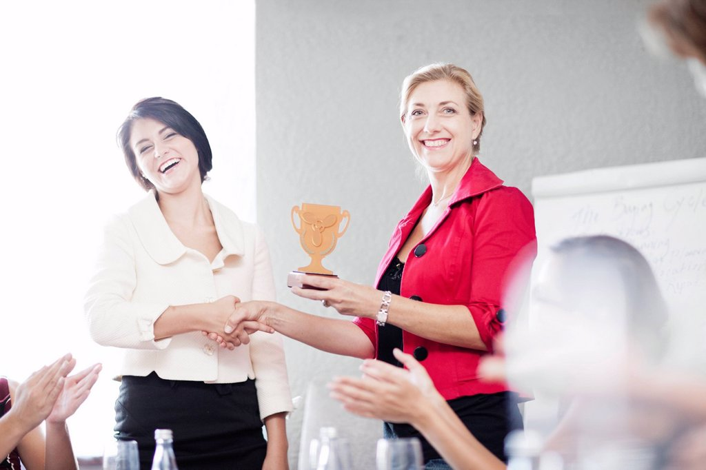 Businesswoman receiving award : Stock Photo
