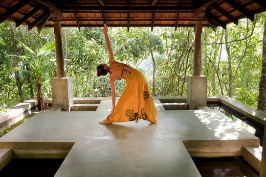 Woman practicing yoga in studio : Stock Photo