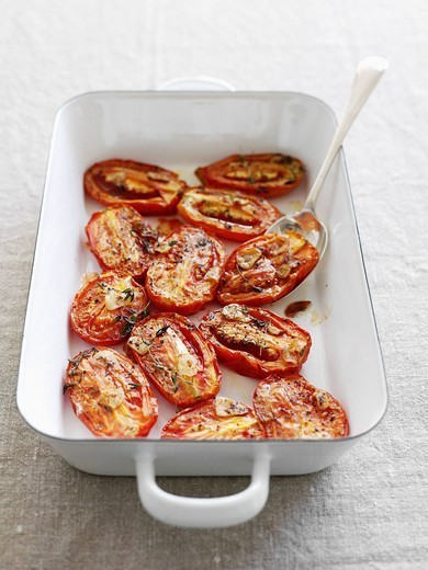 Dish of roasted tomatoes : Stock Photo