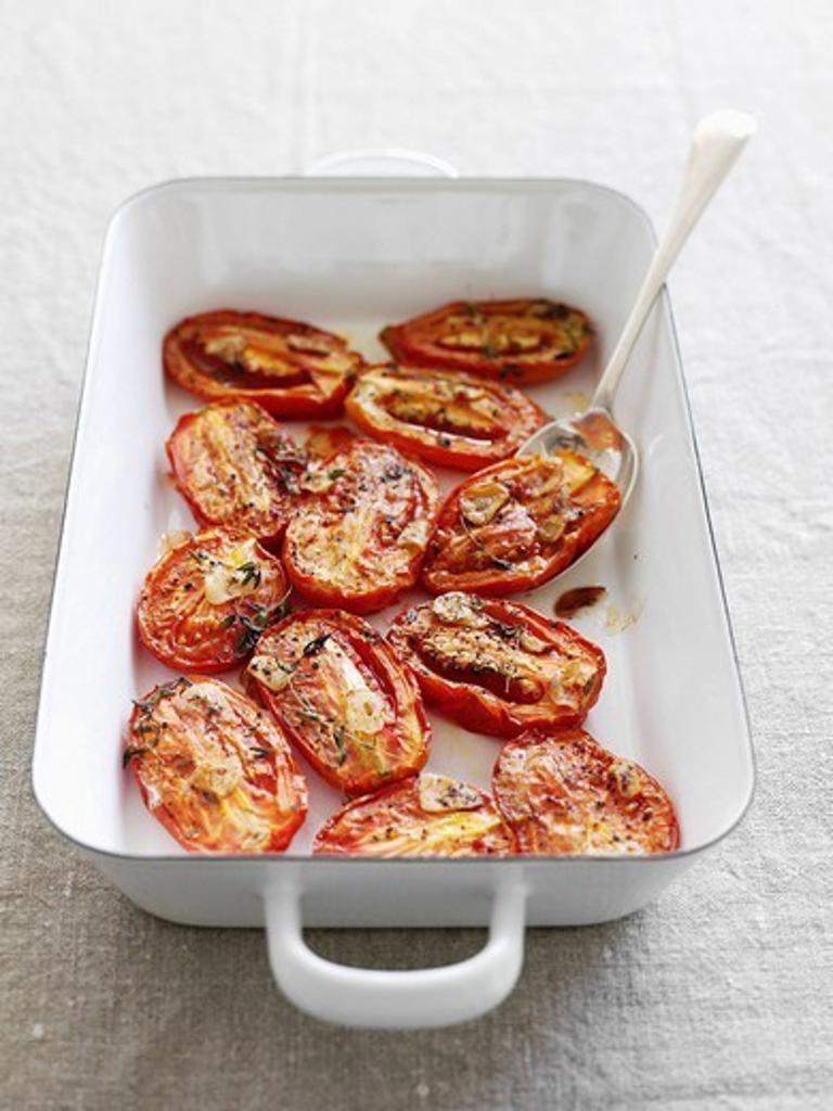 Dish of roasted tomatoes : Stock Photo