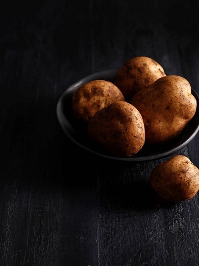 Close up of bowl of potatoes : Stock Photo