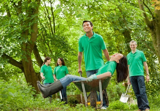 Gardeners playing together in park : Stock Photo