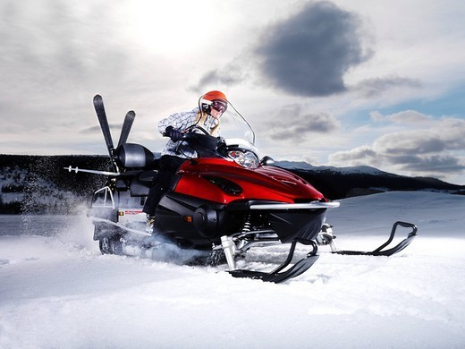 Girl on skidoo. : Stock Photo