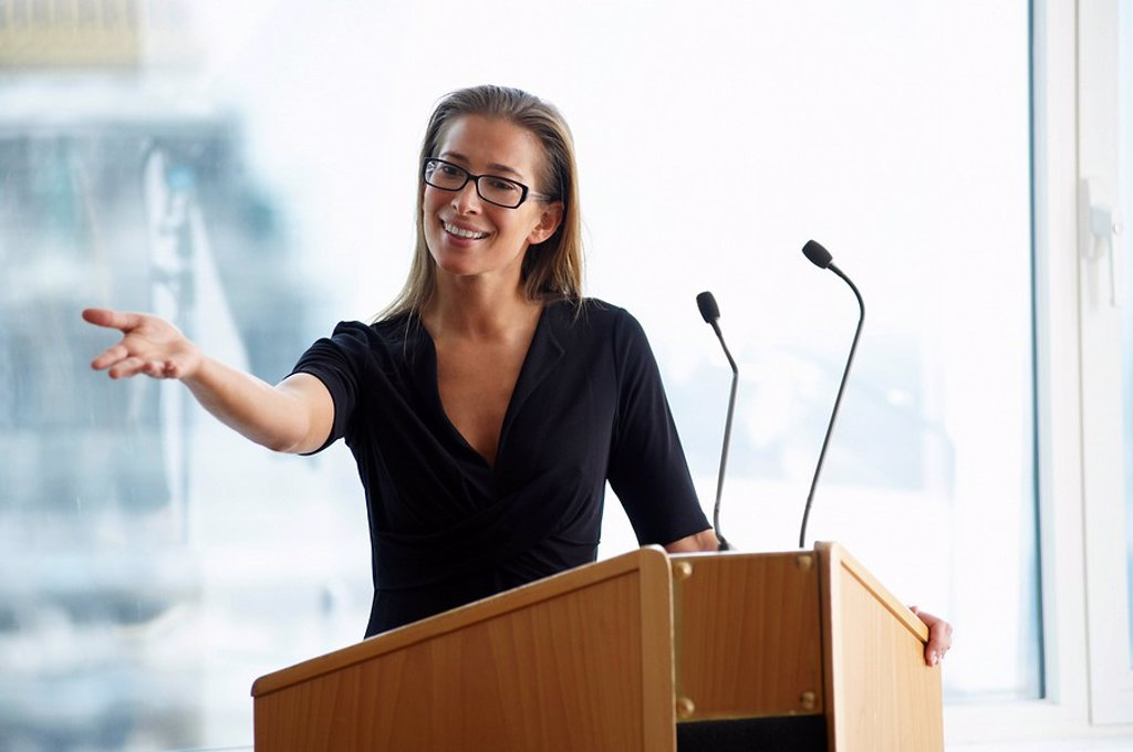 Woman talking during a conference : Stock Photo