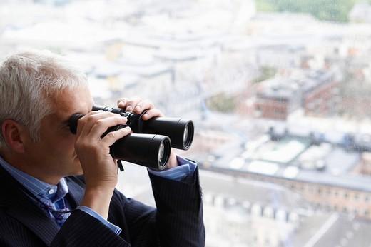 Man with binoculars : Stock Photo