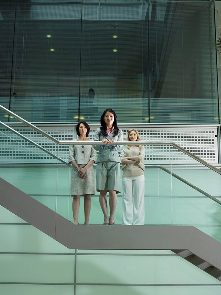 Stock Photo: 1773-55424 Three women standing on stairs