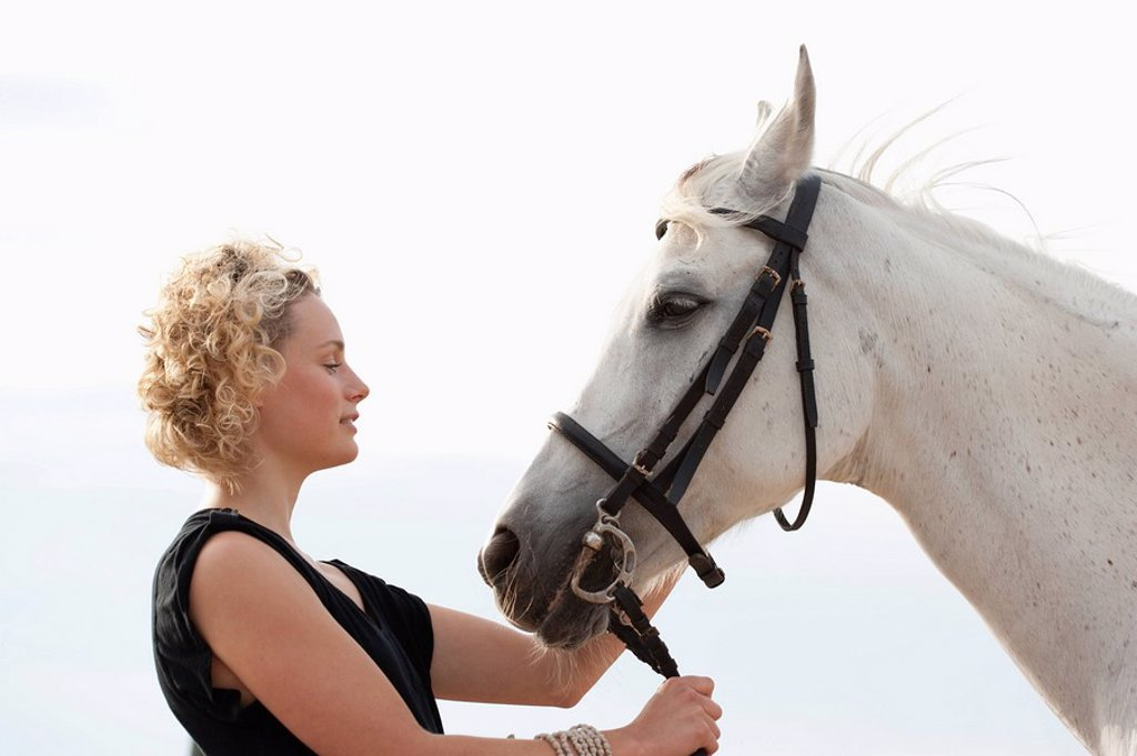 Stock Photo: 1773-55885 woman and man riding horse together