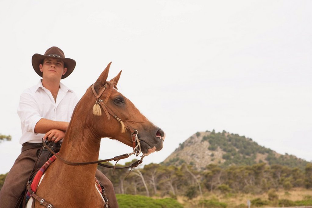 Stock Photo: 1773-55907 man riding horse