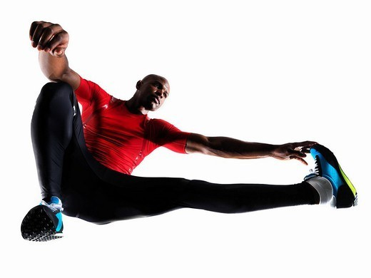 Male athlete stretching : Stock Photo