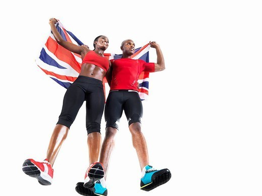 Athletes celebrating with Union Jack : Stock Photo