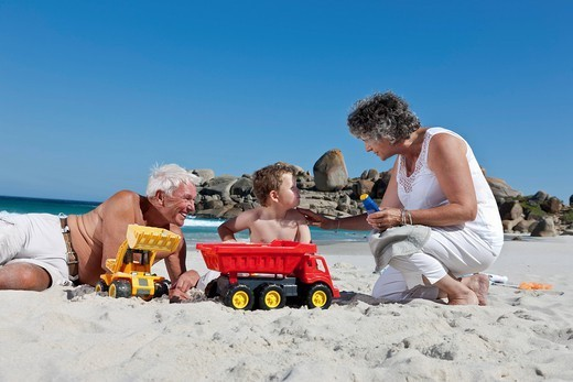 Woman with sunscreen for grandson : Stock Photo