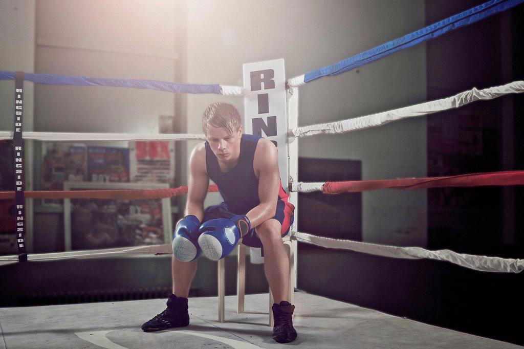 Stock Photo: 1773-57200 Boxer sitting in corner of ring