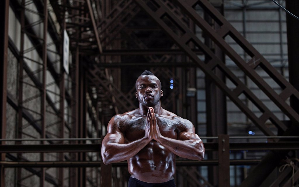 Stock Photo: 1773-57251 Bare_chested athlete in prayer position
