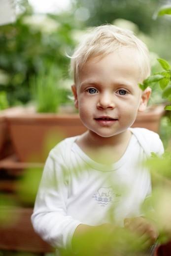Toddler boy smiling in backyard : Stock Photo
