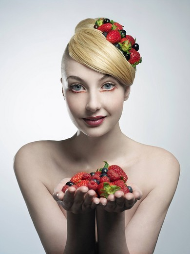 Woman holding handful of fruit : Stock Photo