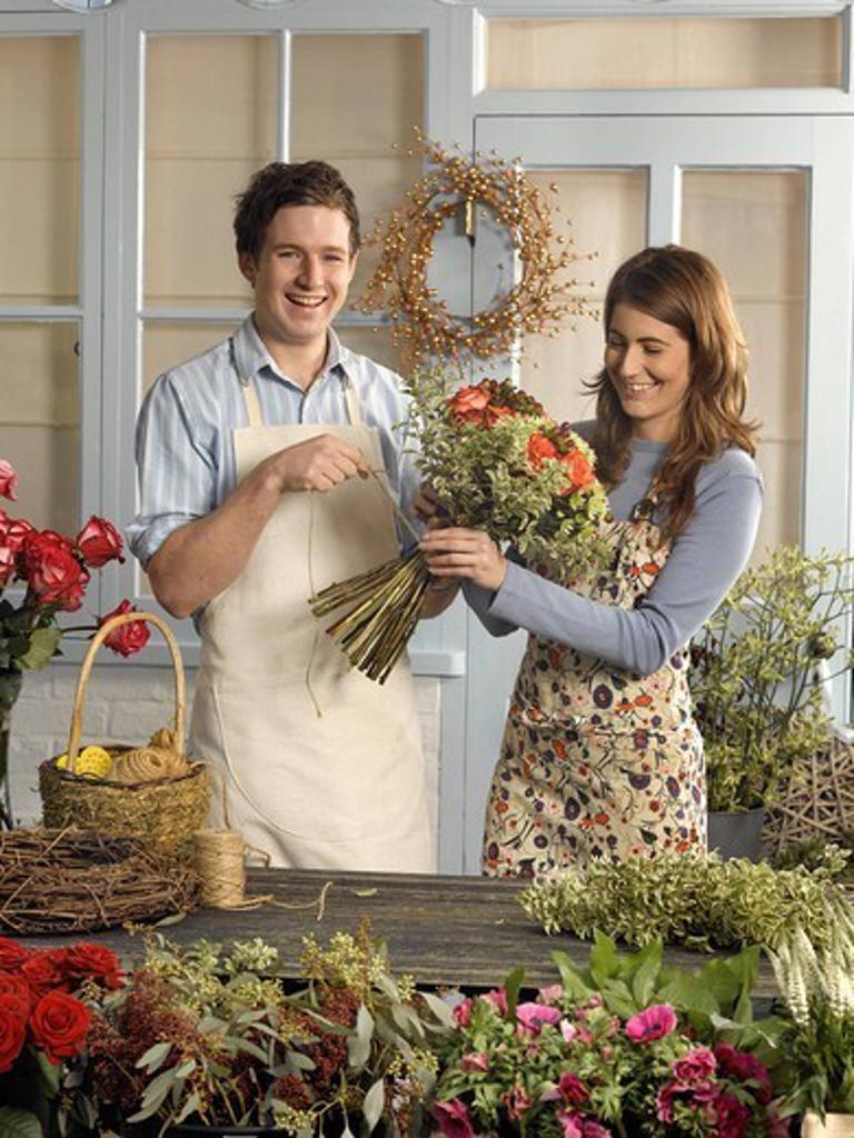 Florists arranging bouquet in shop : Stock Photo