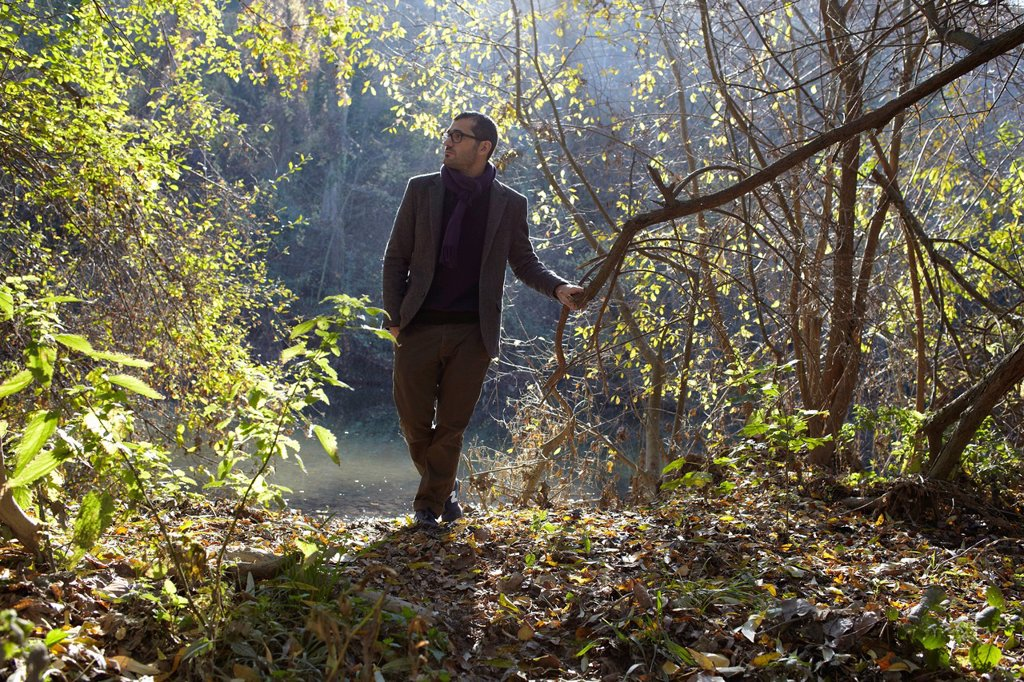 Stock Photo: 1773-58968 Man walking in forest