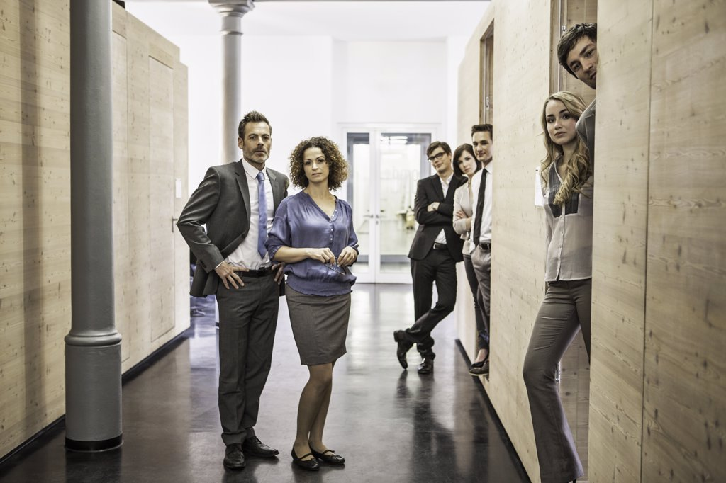 Business people standing in hallway : Stock Photo