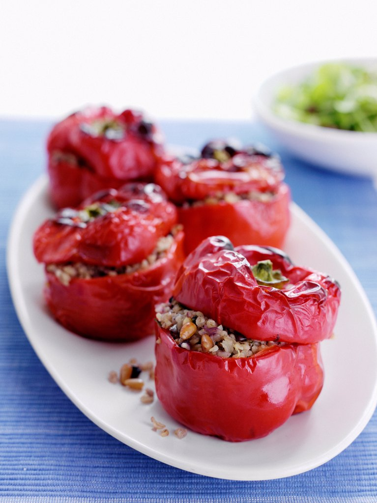 Plate of stuffed roasted peppers : Stock Photo