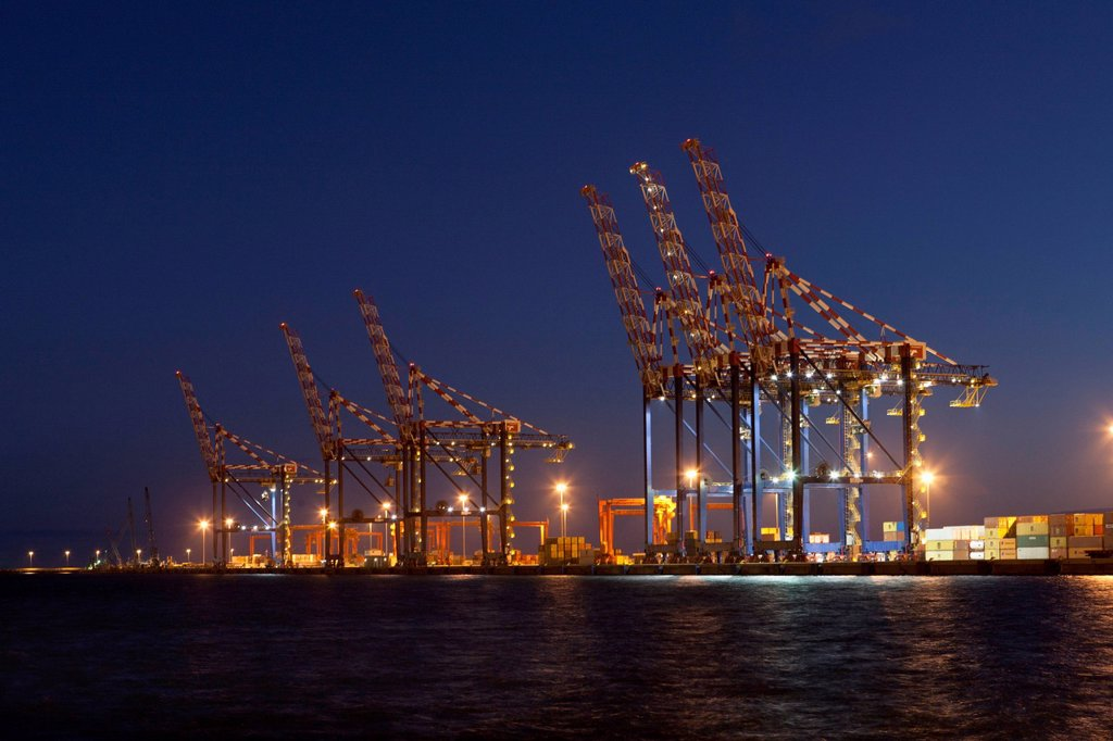 Stock Photo: 1773-95692 Cranes in shipyard lit up at night