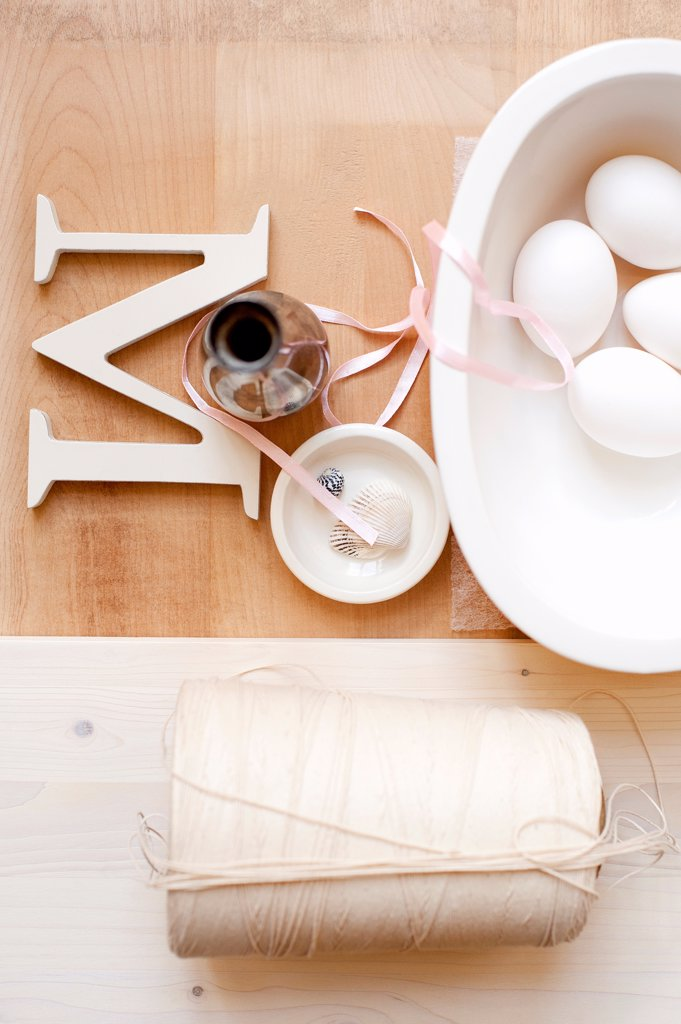 Twine letter M ribbon and eggs : Stock Photo