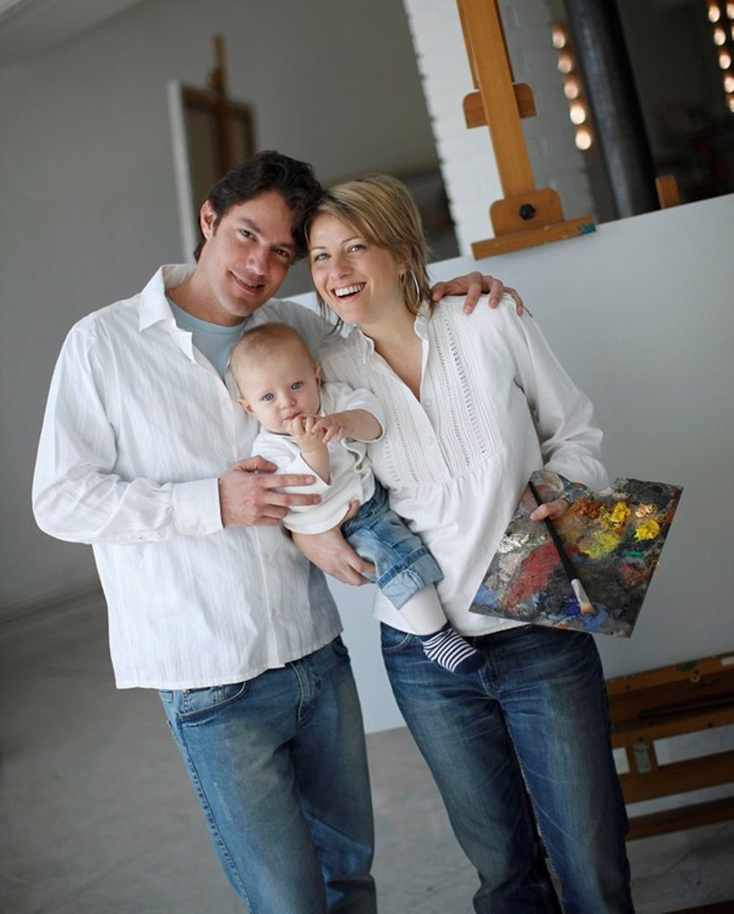 Stock Photo: 1773R-102483 Family posing in art studio