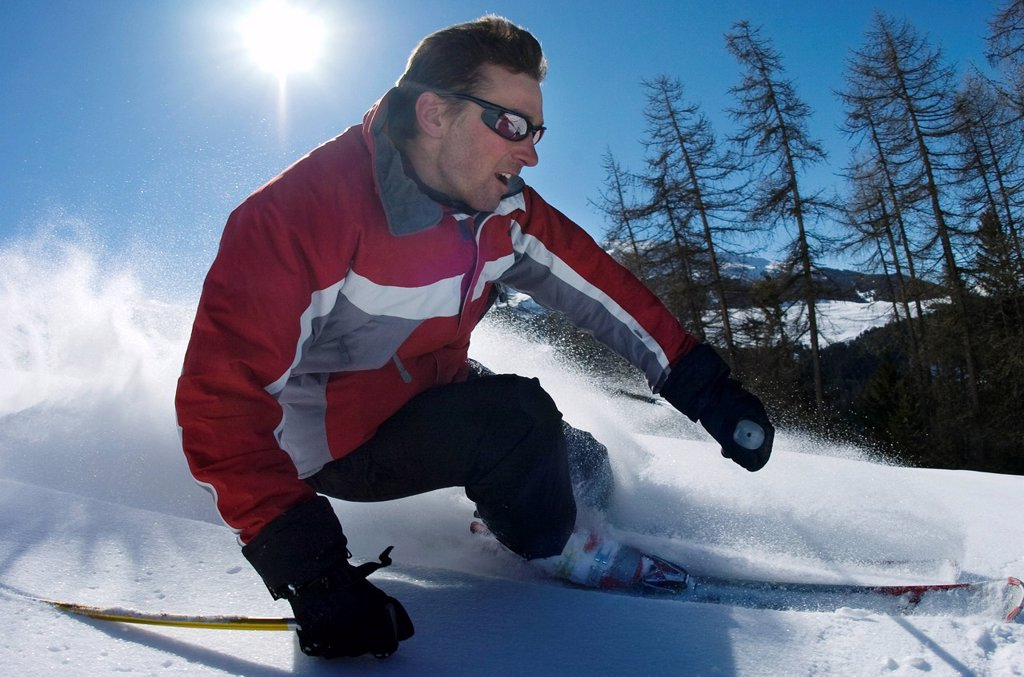 Stock Photo: 1773R-102902 Skier carving through powder snow