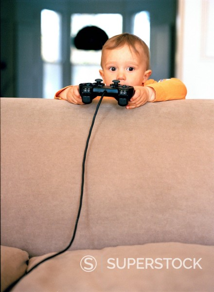Stock Photo: 1773R-107982 Toddler with Video game controller