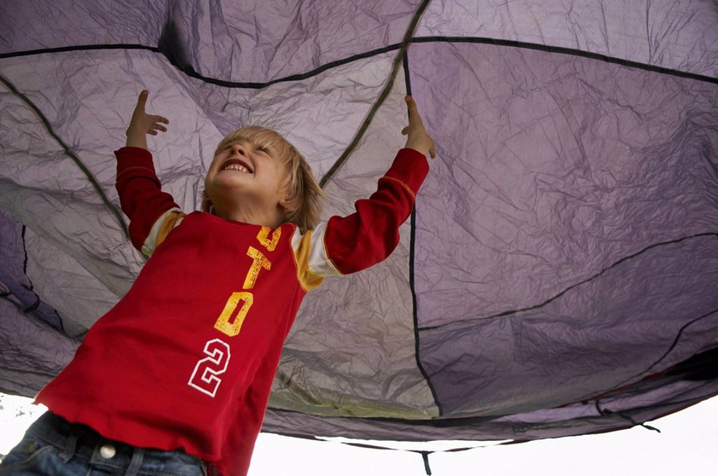 Stock Photo: 1773R-108908 Boy playing under tent