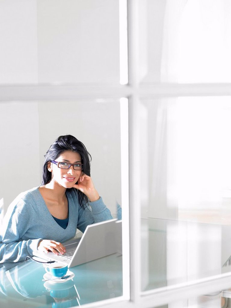Stock Photo: 1773R-109806 Woman working on computer