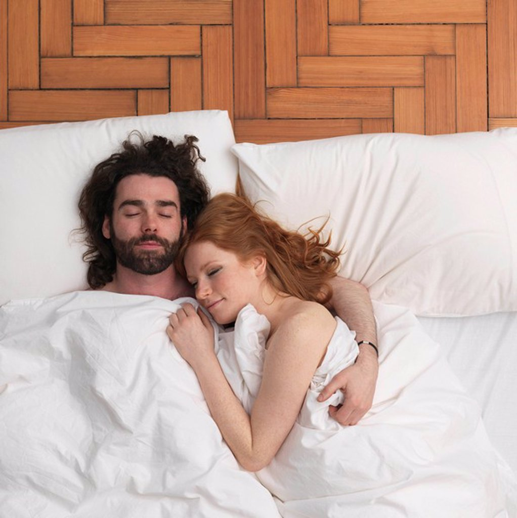 Stock Photo: 1773R-110098 Couple sleeping in bed