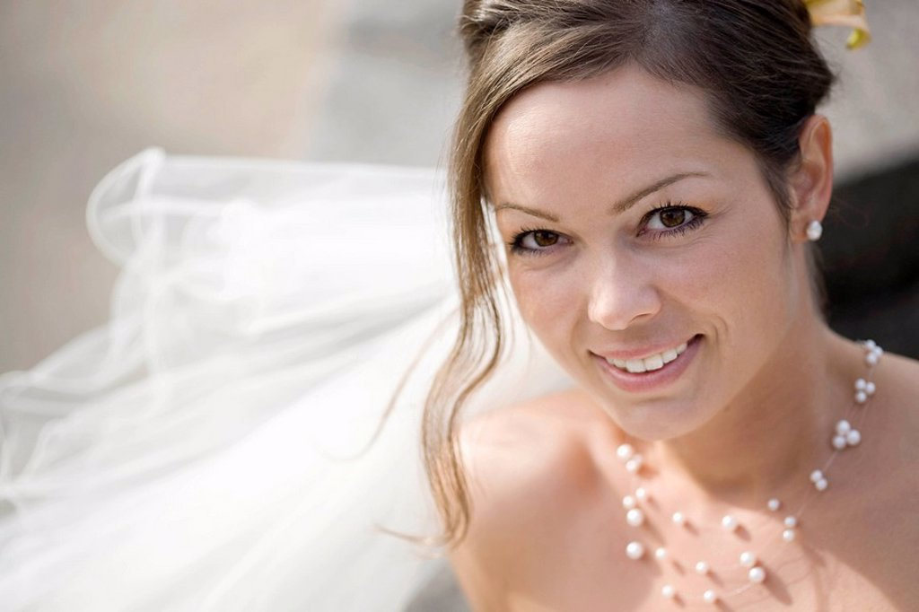 Stock Photo: 1773R-110215 Bride smiling at a camera.