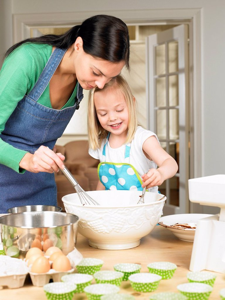 Stock Photo: 1773R-111319 Mother and daughter cooking