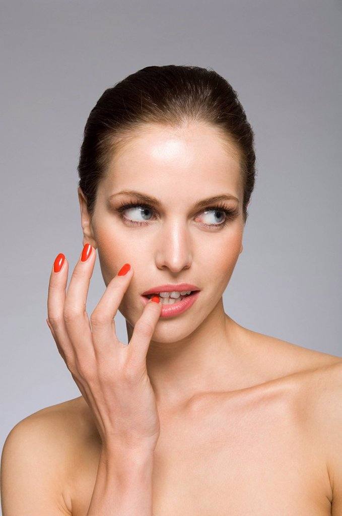 Female beauty model with finger in mouth : Stock Photo