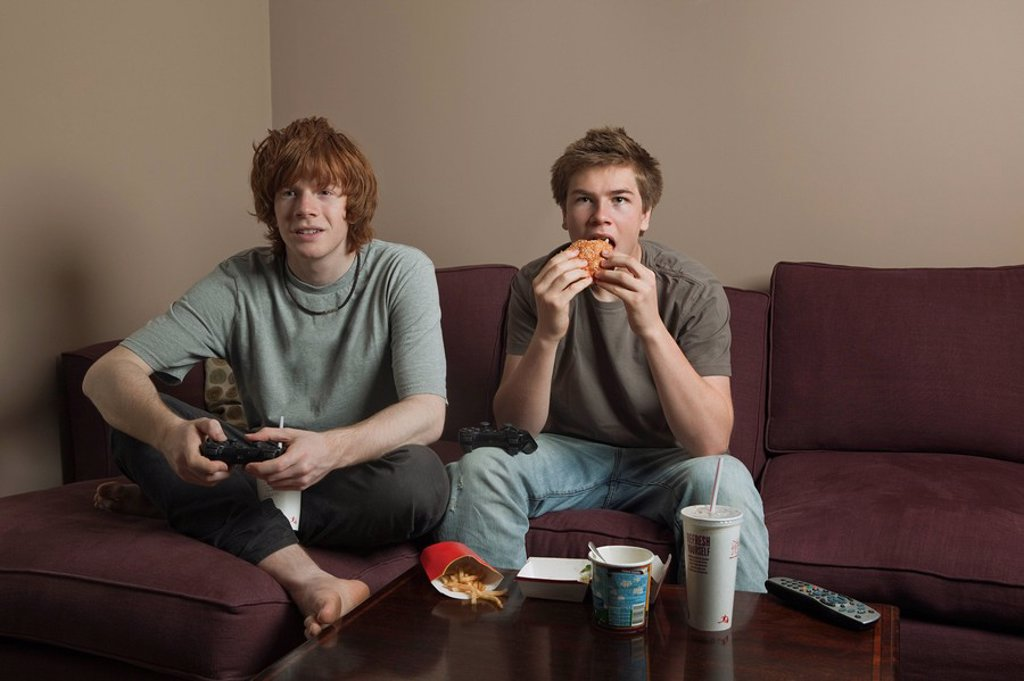 Boys playing video games : Stock Photo