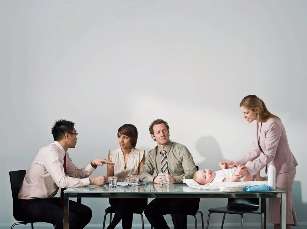 Stock Photo: 1773R-113388 Changing baby´s nappy in a meeting