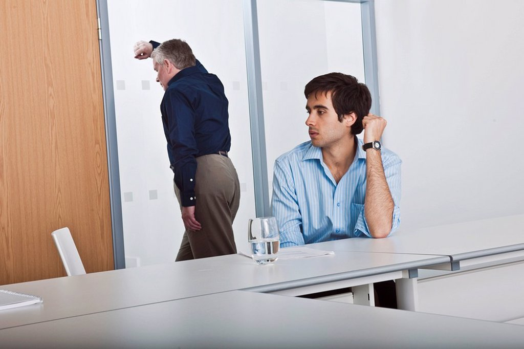 man consoling work colleague : Stock Photo