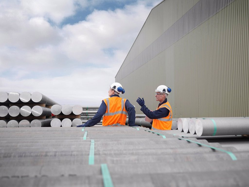 Stock Photo: 1773R-114252 Port Workers Discussing Cargo