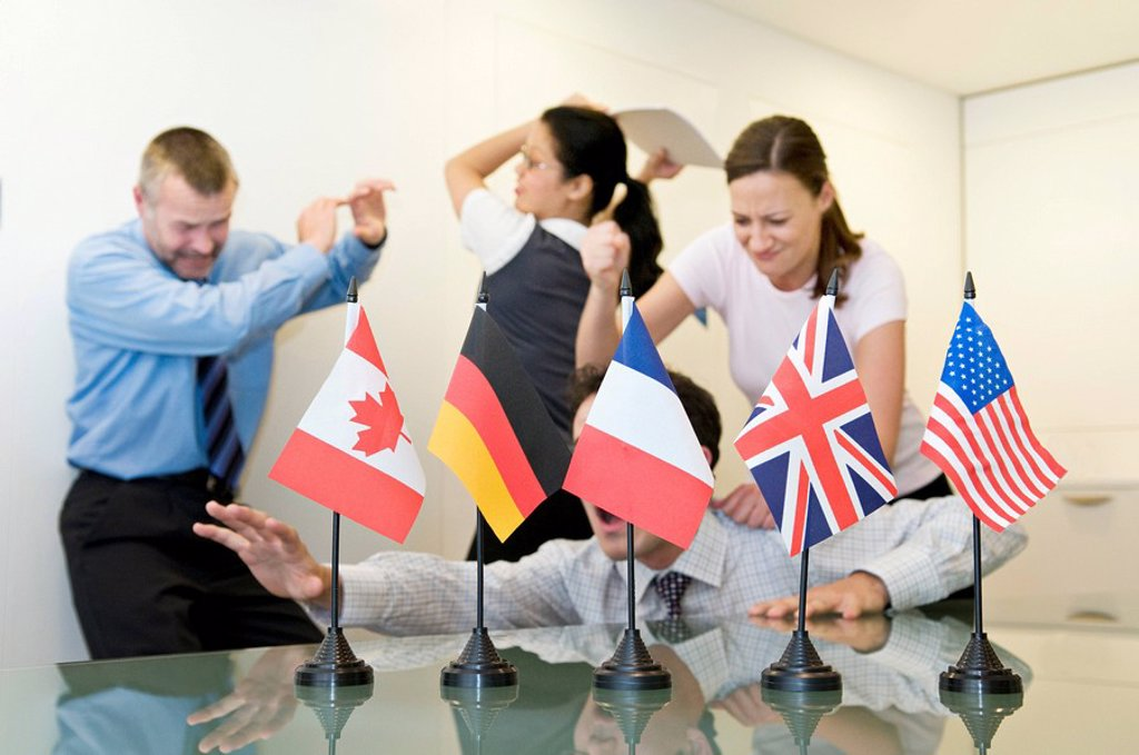 Stock Photo: 1773R-114851 A business group fighting behind flags