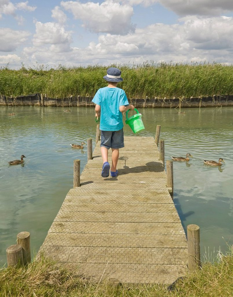 Stock Photo: 1773R-115343 Boy walking on jetty