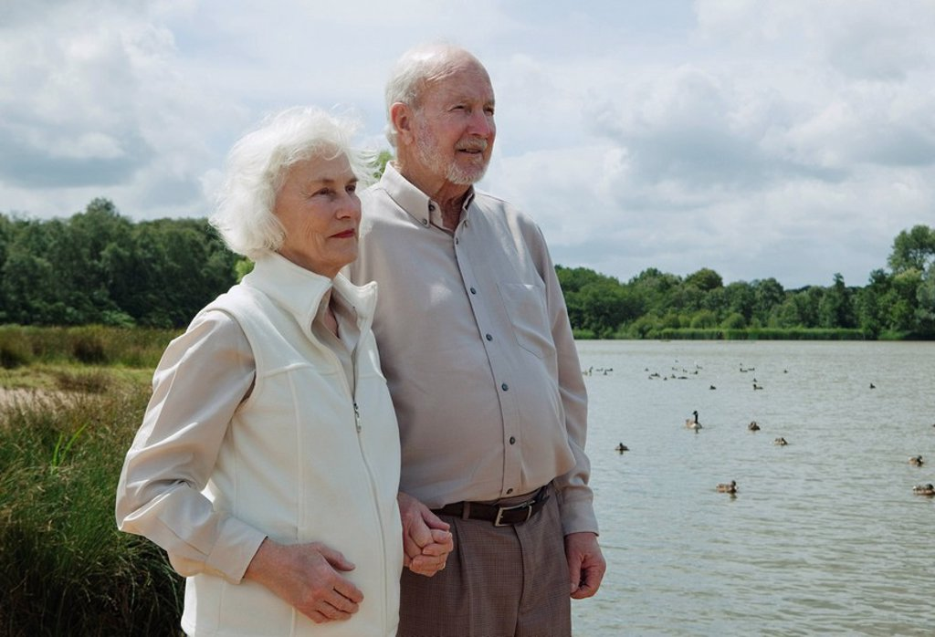 Elderly man holding elderly woman´s hand : Stock Photo
