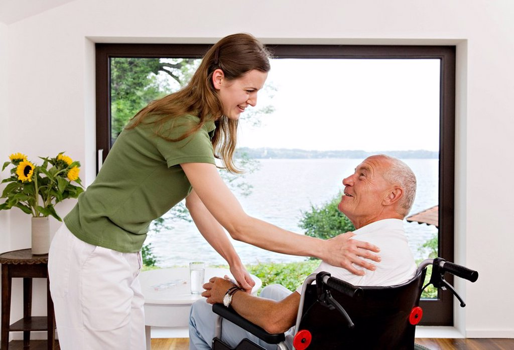 Stock Photo: 1773R-116423 woman touching man in wheelchair