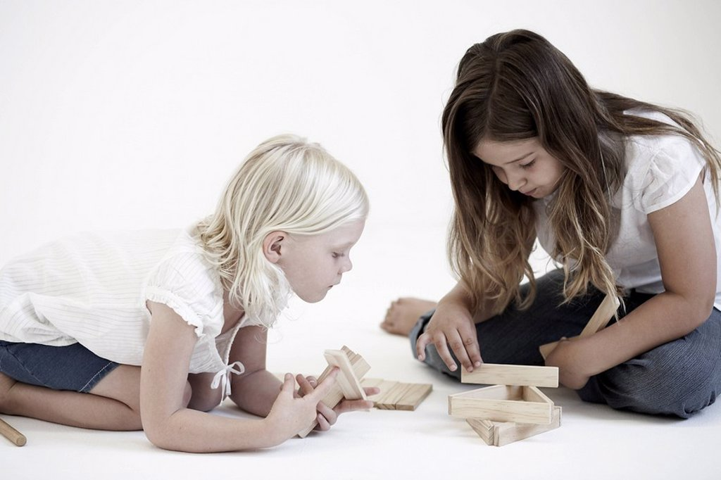 Stock Photo: 1773R-117305 Young girls playing with building blocks