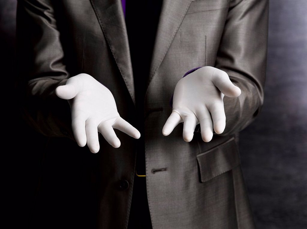 Stock Photo: 1773R-117331 Business man wearing rubber gloves