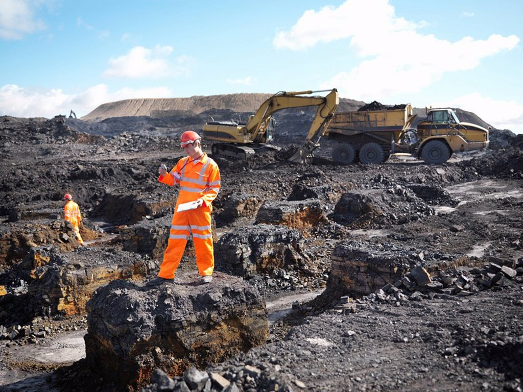 Worker Surveying Coal Mine : Stock Photo