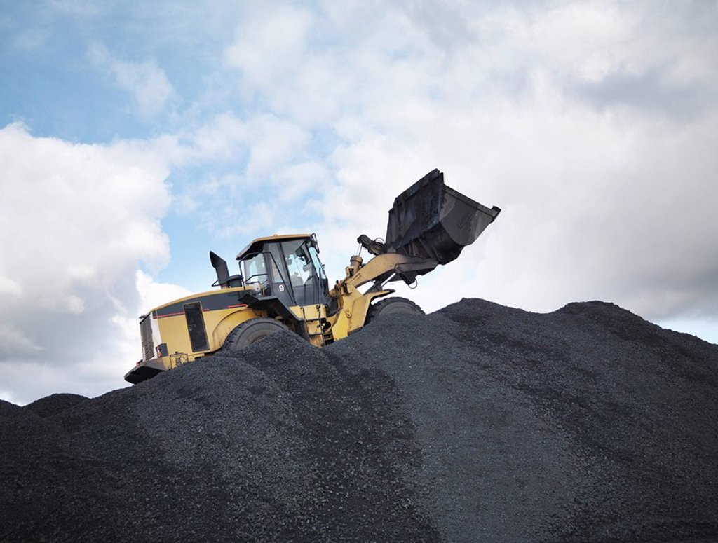 Stock Photo: 1773R-117851 Digger On Pile Of Coal In Mine