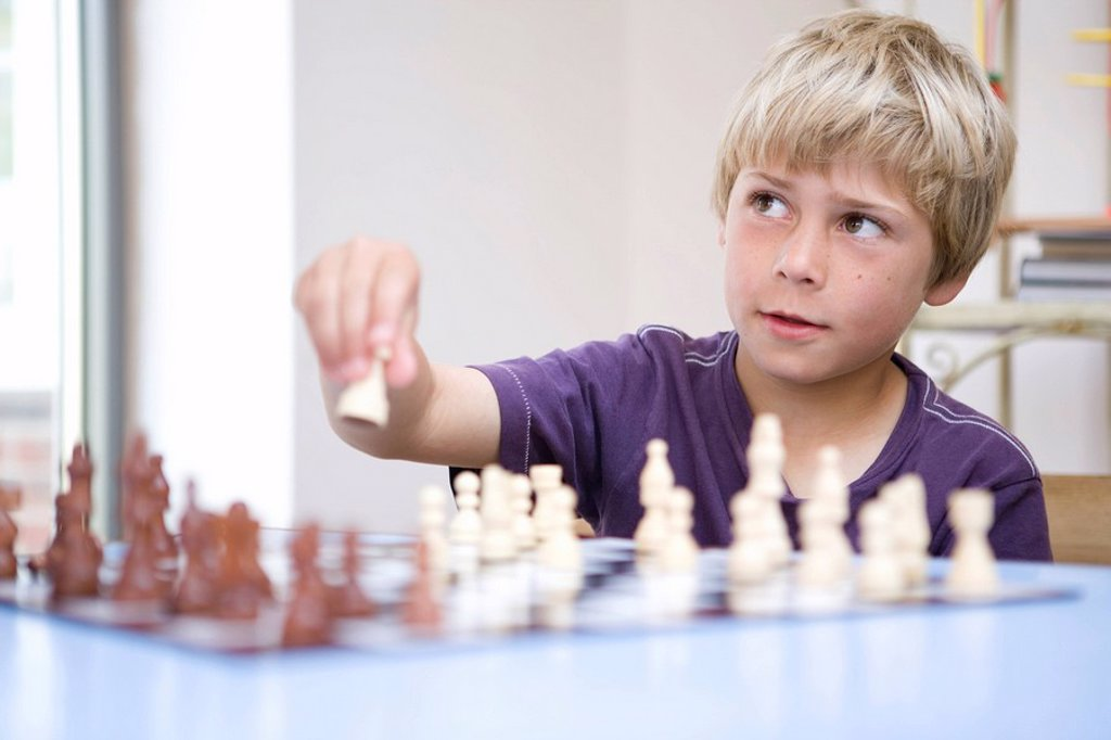 Stock Photo: 1773R-117968 Boy playing chess